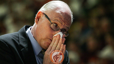 Miami head coach Jim Larrañaga blows his nose on the sidelines during the game. (Mark Umansky/TheKeyPlay.com)