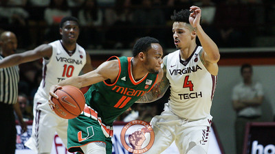 Seth Allen defends Miami's Bruce Brown in the first half. (Mark Umansky/TheKeyPlay.com)