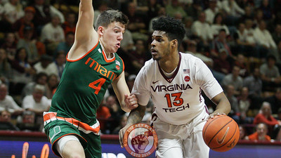 Ahmed Hill looks to dribble past Miami's Dejan Vasiljevic. (Mark Umansky/TheKeyPlay.com)