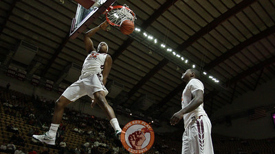 Zach Leday dunks the ball during pregame warmups as Ty Outlaw (right) watches. (Mark Umansky/TheKeyPlay.com)