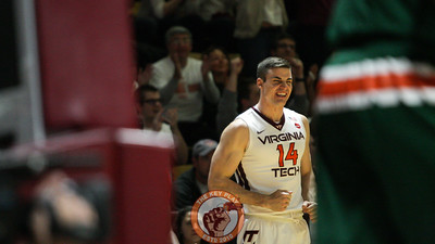 Greg Donlon celebrates from the bench after Virginia Tech draws a foul against Miami. (Mark Umansky/TheKeyPlay.com)