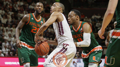 Justin Robinson has the ball knocked away from him by Miami's Bruce Brown in the first half. (Mark Umansky/TheKeyPlay.com)