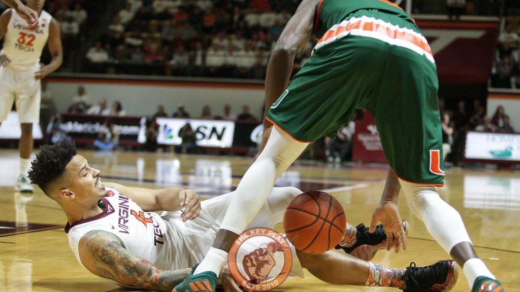 Seth Allen falls to the floor after running into a Miami defender. (Mark Umansky/TheKeyPlay.com)