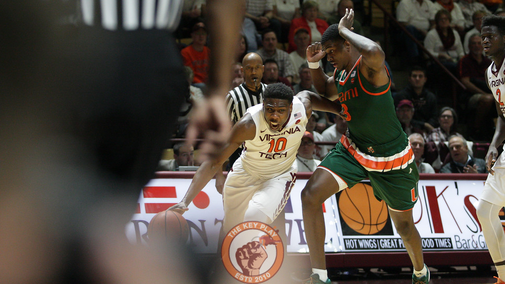 Justin Bibbs dribbles around Miami's Anthony Lawrence, Jr in the first half. (Mark Umansky/TheKeyPlay.com)