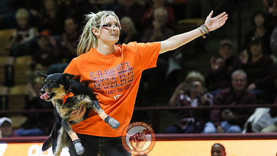 Joan Houghton and one of her dogs thanks the crowd at the end of their halftime performance. (Mark Umansky/TheKeyPlay.com)