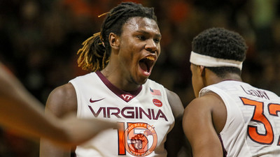 Chris Clarke celebrates a Zach Leday dunk that helps seal the game for the Hokies. (Mark Umansky/TheKeyPlay.com)