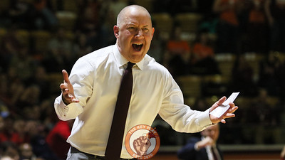 Head coach Buzz Williams voices his displeasure with a foul call against the Hokies. (Mark Umansky/TheKeyPlay.com)