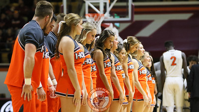 The Virginia Tech cheerleaders prepare for a synchonized stunt during a media timeout. (Mark Umansky/TheKeyPlay.com)