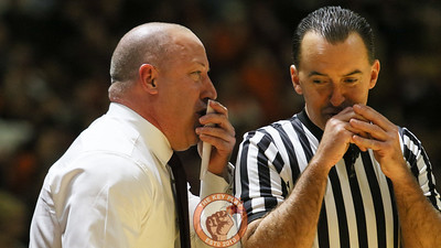 Head coach Buzz Williams exchanges some words with referee Roger Ayers. (Mark Umansky/TheKeyPlay.com)