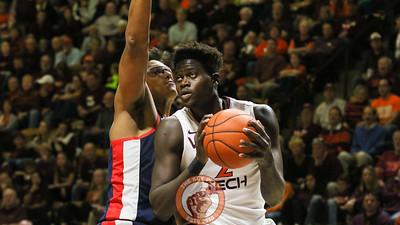 Khadim Sy picks up his dribble under the basket in the second half. (Mark Umansky/TheKeyPlay.com)