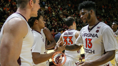 Ahmed Hill celebrates with Tyrie Jackson and Greg Donlon after the final whistle. Virginia Tech defeated Mississippi 80-75. (Mark Umansky/TheKeyPlay.com)