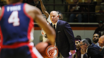 Head coach Buzz Williams looks down the sideline at his counterpart at the beginning of play. (Mark Umansky/TheKeyPlay.com)