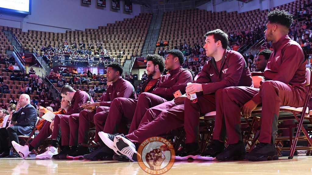 Members of the team sit and wait for the selection show to begin. (Michael Shroyer/TheKeyPlay.com)