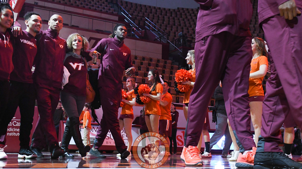 Justin Robinson enters Cassell arm in arm with his family. (Michael Shroyer/TheKeyPlay.com)