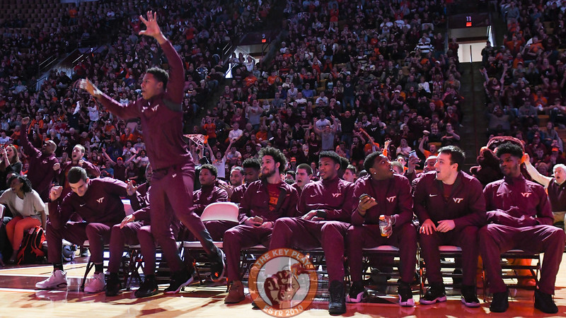 Zach LeDay leaps from his chair immediately following the announcement of the Hokies as an 9 seed. (Michael Shroyer/TheKeyPlay.com)