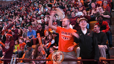 Two members of the Cassell Guard cheer on the team. (Michael Shroyer/TheKeyPlay.com)