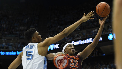Virginia Tech Hokies forward Zach LeDay (32) attempts a layup around North Carolina Tar Heels forward Tony Bradley (5). (Michael Shroyer/ TheKeyPlay.com)