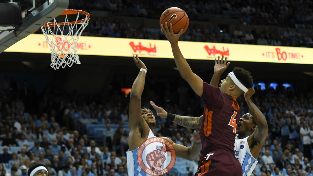 Virginia Tech Hokies guard Seth Allen (4) attempts a layup over North Carolina Tar Heels forward Kennedy Meeks (3). (Michael Shroyer/ TheKeyPlay.com)