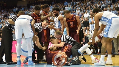 Referee's and players join together to separate the pile. (Michael Shroyer/ TheKeyPlay.com)