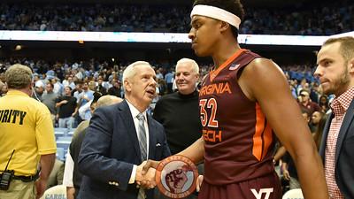 North Carolina Tar Heels head coach Roy Williams shakes hands with Virginia Tech Hokies forward Zach LeDay (32) following the game. (Michael Shroyer/ TheKeyPlay.com)