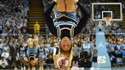 A North Carolina Tar Heels cheerleader performs during a timeout. (Michael Shroyer/ TheKeyPlay.com)