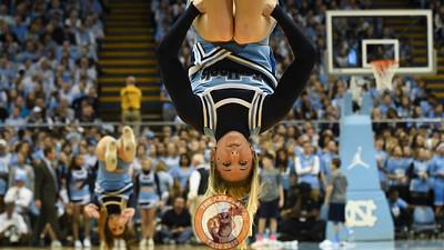 A North Carolina Tar Heels cheerleader performs during a timeout. (Michael Shroyer/ TheKeyPlay.com)