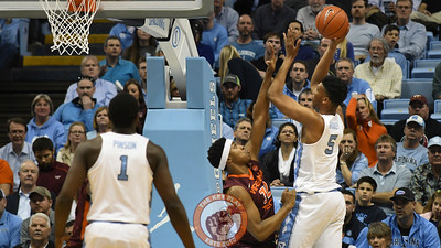 North Carolina Tar Heels forward Tony Bradley (5) shoots over Virginia Tech Hokies forward Zach LeDay (32) in the first half. (Michael Shroyer/ TheKeyPlay.com)