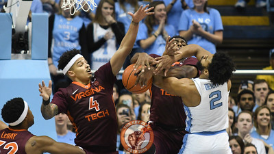 Virginia Tech Hokies guard Seth Allen (4) and guard Justin Bibbs (10) battle for the ball with North Carolina Tar Heels guard Joel Berry II (2). (Michael Shroyer/ TheKeyPlay.com)