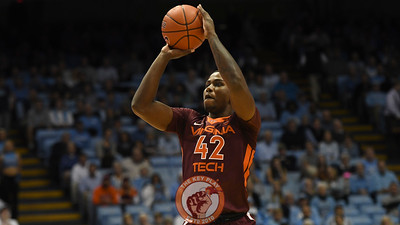 Virginia Tech Hokies guard/forward Ty Outlaw (42) shoots a three pointer. (Michael Shroyer/ TheKeyPlay.com)
