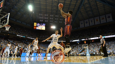 Virginia Tech Hokies guard Ahmed Hill (13) shoots a corner three over North Carolina Tar Heels forward/guard Justin Jackson (44). (Michael Shroyer/ TheKeyPlay.com)