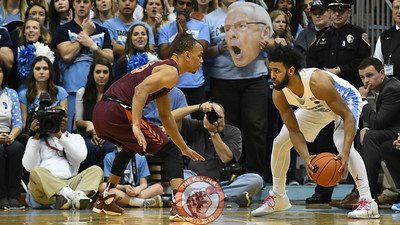 Virginia Tech Hokies guard Justin Robinson (5) defends North Carolina Tar Heels guard Joel Berry II (2). (Michael Shroyer/ TheKeyPlay.com)