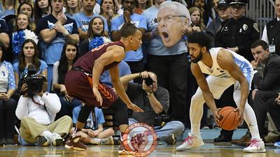 Virginia Tech Hokies guard Justin Robinson (5) defends North Carolina Tar Heels guard Joel Berry II (2). (Michael Shroyer/ TheKeyPlay.com)