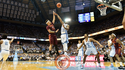 Virginia Tech Hokies guard Seth Allen (4) attempts a floater from just outside the lane over North Carolina Tar Heels guard Kenny Williams (24). (Michael Shroyer/ TheKeyPlay.com)