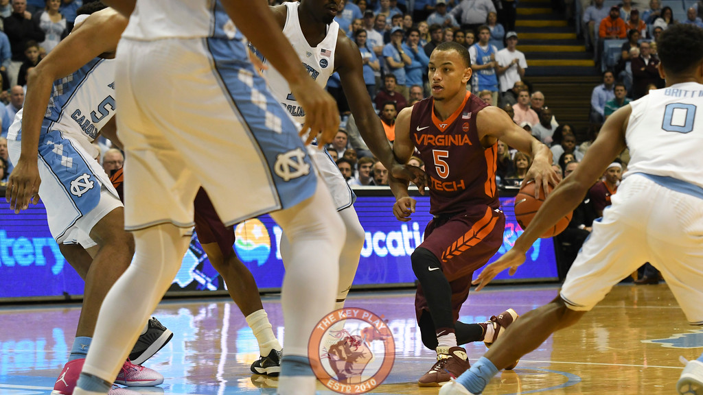 Virginia Tech Hokies guard Justin Robinson (5) dribbles into traffic. (Michael Shroyer/ TheKeyPlay.com)