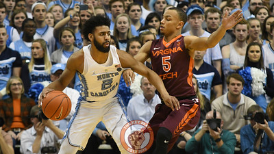 Virginia Tech Hokies guard Justin Robinson (5) defends North Carolina Tar Heels guard Joel Berry II (2) in the second half. (Michael Shroyer/ TheKeyPlay.com)