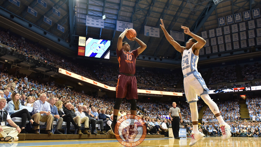 Virginia Tech Hokies guard Justin Bibbs (10) shoots a three pointer over North Carolina Tar Heels guard Kenny Williams (24). (Michael Shroyer/ TheKeyPlay.com)