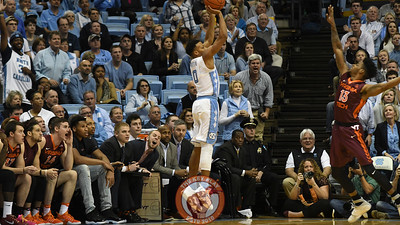 North Carolina Tar Heels guard Nate Britt (0) shoots over the late arriving Virginia Tech Hokies guard Ahmed Hill (13) on one of several successful first half Carolina three pointers. (Michael Shroyer/ TheKeyPlay.com)