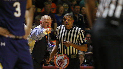 Buzz Williams points out a player to referee Teddy Valentine during a break in the action. (Mark Umansky/TheKeyPlay.com)