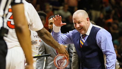 Head coach Buzz Williams high fives a player as they walk towards the bench during a timeout. (Mark Umansky/TheKeyPlay.com)