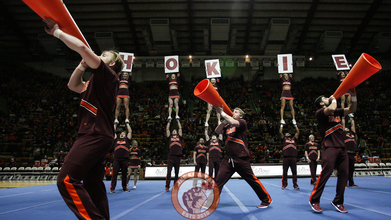 The Virginia Tech cheerleaders perform their nationals routine for the crowd during halftime. (Mark Umansky/TheKeyPlay.com)
