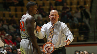 Head coach Buzz Williams gives instructions to Ty Outlaw in the second half before coming in the game. (Mark Umansky/TheKeyPlay.com)