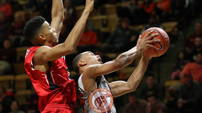 Justin Robinson is fouled from behind as he attempts a layup. (Mark Umansky/TheKeyPlay.com)