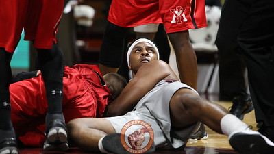 Zach Leday looks up at a referee after a jump ball is called after a struggle for a loose ball. (Mark Umansky/TheKeyPlay.com)