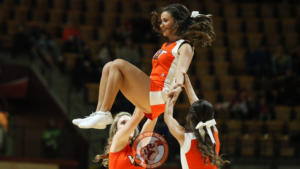 A trio of cheerleaders perform for the crowd in the first half. (Mark Umansky/TheKeyPlay.com)