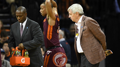 Former Virginia Tech head football coach Frank Beamer inspects the team's gatorade supply during a first half timeout. (Michael Shroyer/ TheKeyPlay.com)