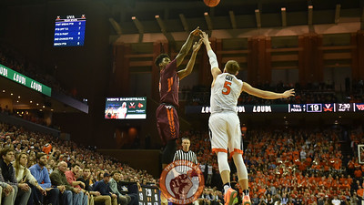 Virginia Tech Hokies guard Ahmed Hill (13) shoots a three pointer over Virginia Cavaliers guard Kyle Guy (5). (Michael Shroyer/ TheKeyPlay.com)