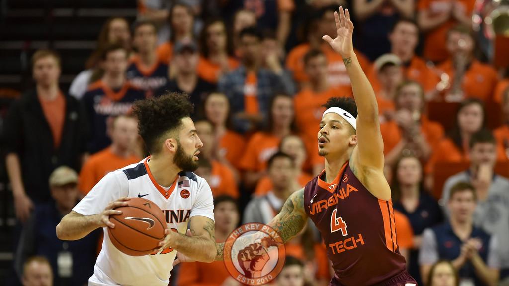 Virginia Tech Hokies guard Seth Allen (4) defends Virginia Cavaliers guard London Perrantes (32) in the first half. (Michael Shroyer/ TheKeyPlay.com)