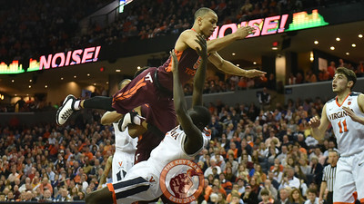 Virginia Cavaliers guard Marial Shayok (4) draws a charging foul on Virginia Tech Hokies guard Justin Robinson (5). (Michael Shroyer/ TheKeyPlay.com)