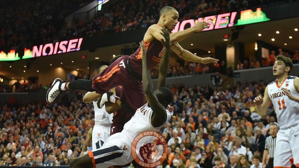 Virginia Cavaliers guard Marial Shayok (4) draws a charging foul on Virginia Tech Hokies guard Justin Robinson (5). (Michael Shroyer/ TheKeyPlay.com)