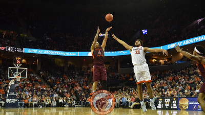 Virginia Tech Hokies guard Seth Allen (4) attempts a three pointer over Virginia Cavaliers forward Isaiah Wilkins (21). (Michael Shroyer/ TheKeyPlay.com)